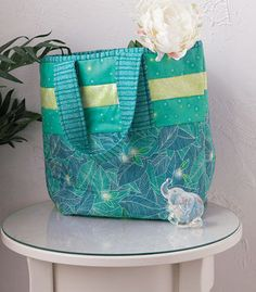 Fun easy to sew tote bag! Strip To The Beach Bag Kit - Small by GE Designs in cool calm aqua blues, and peridot green. Great for a day trip or even just as a extra tote in your car, this bag is almost as easy to sew as it will be to fill it!Kit in...