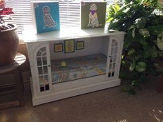 RePurposed TV console dog bed with custom-made cushion and art.
