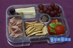 A tasting of some of the delicious foods we picked up at the Italian Market. Mortadella, Fontina cheese, assorted olives, crostini crackers, tomato salad, grapes and a chocolate wafer cookie.
