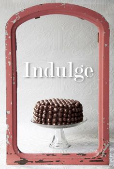 Indulge: Malt Balls dusted in edible gold dust covering a chocolate layer cake