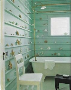 This would be so cute for a kid's bathroom at a beach house. They could show off all their cool beach findings :)