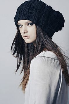 Oversized! We love this head-topper, but could you smile, please? It makes the hat look nicer :)
