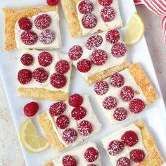 A flaky puff pastry tart filled with lemon cream and topped with fresh raspberries. An easy and elegant spring or summer dessert. #fruittart #tart #lemon #dessert #baking #puffpastry