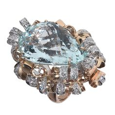 This ring is 18k Rose and white Gold and 20 Carat Pear Shaped Aquamarine Center Stone. Round Diamonds weighing approximately 0.80ctw. This ring is a size 8. Weight 25.2gr.Italy  Circa 1945