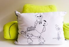 My son loves to draw so I turned one of his drawings in to a pillow! It's a great way to add your kid's art to your home decor. These are a great gift idea for grandparents!