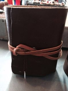Handmade leather journal with 300 pages of acid free archive quality paper. Www.writtentreasures.bigcartel.com