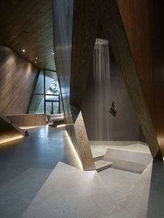 Neat geometry. I love the inset baseboard lighting. The thick wood is a nice touch, although I don't like that grain (walnut? oak?). I would've gone with wenge or ebony-stained beech. [Abstract Open Bathroom Design with Hidden Shower]