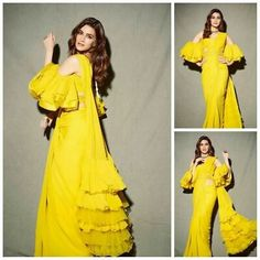 Ruffle Saree Style is the Hottest Trend of this Season 2018 - - Ruffle saree is a traditional saree style with a twist are the major attraction for the Bollywood actresses. Indian Gowns Dresses, Indian Fashion Dresses, Dress Indian Style, Indian Designer Outfits, Bridal Dresses, Fashion Outfits, Stylish Sarees, Stylish Dresses, Trendy Sarees