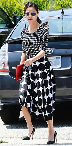 Jamie Chung played with polka dots with separates from the upcoming Banana Republic Marimekko Collection, accessorizing with aviators, a Kate Spade Saturday envelope clutch, and black pumps.