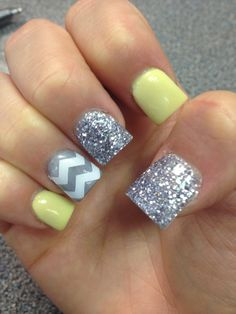 Yellow and silver nails with gray and white chevron stripe.