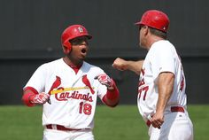 St. Louis Cardinals' Oscar Taveras (left) reacts after driving in the go-ahead run with a single in seventh inning action during a game betw...