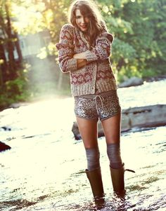 glitter shorts, knits, and rubber boots