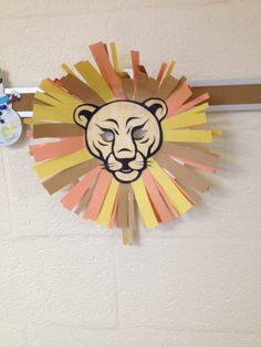 Lion: Construction Paper. Cardstock paper and print photo of a lion, Popsicle stick, paper plate.