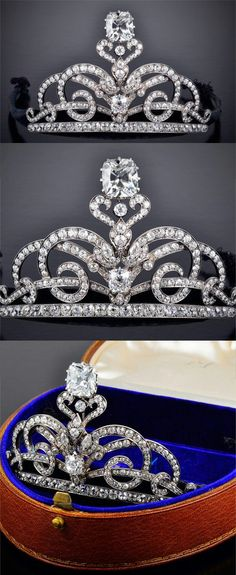 AN ANTIQUE DIAMOND TIARA   Designed as intertwined scrolling lines set with old-cut diamonds, on a diamond-set line base, centering upon a cushion-shaped diamond under a foliate motif, surmounted by a cushion-shaped diamond, weighing 14.29 carats, to the detachable gold headband, covered with black velvet, mounted in silver and gold, circa 1900, in brown leather case.  Formerly the property of Dame Miriam Rothschild DBE, FRS
