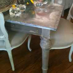 distressed wood table with metal top. {courtesy of the shop around the corner in franklin} Aesthetic Objects, Distressed Wood, Kitchen Islands, Art Furniture, How To Distress Wood, Wood Table, Textile Design, Repurposed, Coastal