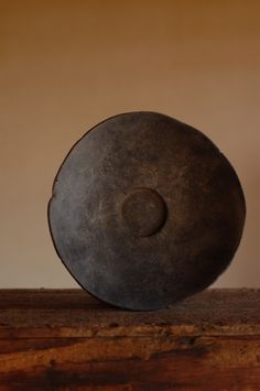 circle. plate. dark brown. ebony. round. browns. earthy.   RP » Yukiharu Kumagai