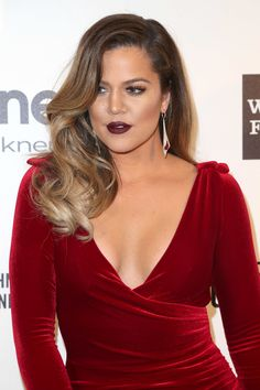 Waves and a dark, berry lip made for a smoldering look on Khloé.