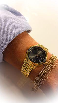 Gold-tone watch. Style it solo or alongside bracelets.