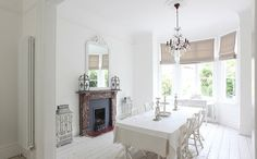 The bones of this beautiful Victorian are the perfect backdrop to the simple but elegant furnishings in this home. The many fireplaces along with the white washed wood floors and bright white walls help to create a beautiful flow throughout the space. What I think is so interesting is the mi