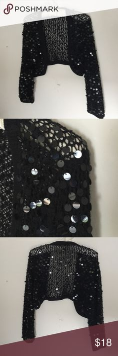 Vintage:  The ultimate black sequined bolero! Vintage:  Take your favorite little black dress and make a statement with this stunning sequined knitted bolero.  Fits sizes S/M/L, you can't go wrong with this beautiful eye-catching piece.  And, get creative and pair this bolero with other colors then black.  This piece is as fun as it is versatile and will quickly become one of your favorites! Vintage  Jackets & Coats