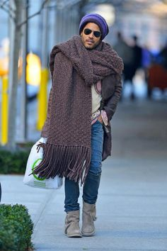 Lenny Kravitz Scarf Game. That's not a scarf, he just grabbed a blanket on his way out.