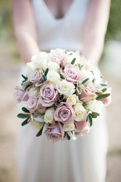 A beautiful bridal bouquet of lavender and white/cream roses. Roses are available year-round in a wide variety of colors at GrowersBox.com.