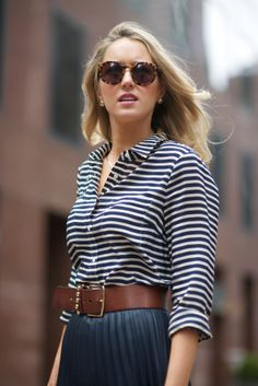 classy look with striped blouse, navy a line skirt and waist belt. The 70s sunglasses fit it so well in my opinion. The look is presented by a smaller sized woman but I would dare to wear this with my size 14-16