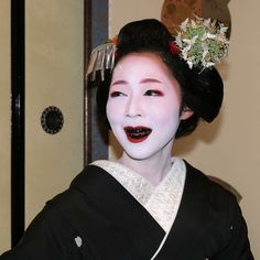 A senior maiko in the week before her advancement to geiko.  Her teeth have been blackened (called ohaguro) as a traditional beauty and status mark.  Women during the heian era practiced ohaguro.