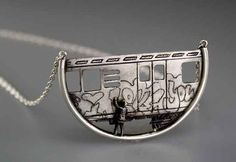 A necklace with customizable graffiti.