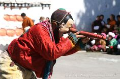 During a tsechu in Bhutan... a wooden phallus is used as a binocular by a clown - http://www.iviaggidelcapo.it/