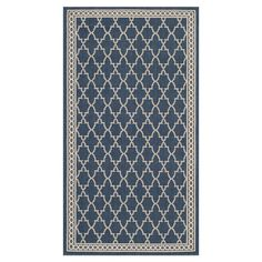 Anchor your sunroom or patio seating arrangement in chic style with this elegant indoor/outdoor rug, showcasing a trellis motif in navy and beige. ...