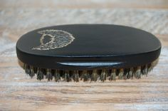 Natural Boar's Hair Military Style Beard Brush - This manly beard brush is an essential item in any man's beard maintenance kit. We all know that great beards come with great responsibility. This brush will keep the beard looking great and tame. The wooden body is the perfect size and has a nice gloss finish. The bristles are stiff enough to penetrate his beard but not too stiff on his skin. Change your man from a homeless hillbilly to a well-manicured hipster in minutes. $20 on Etsy