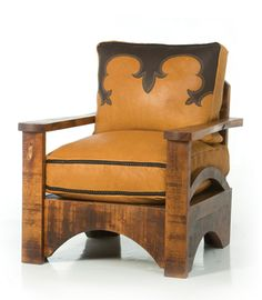 MESQUITE ARMCHAIR WITH BOOT-STITCHING- Made of western Mesquite, this solid and rugged chair has boot-stitched buffalo cushions with contrasting braid edging. Select from saddle tan with black trim or black leather with red trim.