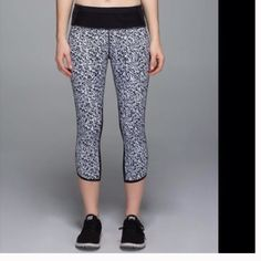 Lululemon cropped leggings Lululemon push pacers cropped leggings. Size 2. Never warn before, comes with dark mesh on the back of the pants, zipper pouch on the back of waistband, mesh pouches on the front of the waistband, and cut out accent holes going up the side of the leg with reflective material on the sides/bottom of the pant. lululemon athletica Pants Leggings