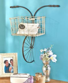 Enjoy the versatile use of this Metal Bicycle Wall Basket. Perfect for an entryway, porch and more, this whimsical wall decor resembles the front of an antique bike. Each is intentionally distressed f