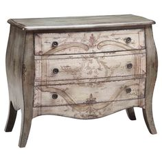Hand-painted bombe chest with 3 drawers and a scrolling leaf motif.   Product: ChestConstruction Material: Wood...