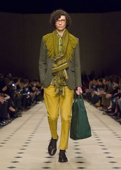 A linen jacket in dark cedar green worn over a quilted jacket in floral print cotton with runway accessories