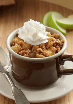 This Easy Apple Crisp recipe is made in microwaveable mugs with tart apples, sweet granola, brown sugar, and cinnamon. This is the perfect fall dessert!