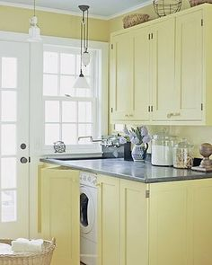 The unique cabinet color make this a beautiful laundry room.