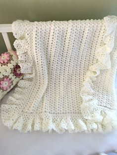 Deborah O'Leary ♥ on Etsy This lovely baby blanket has a timeless quality. It is light and lacy and is accented with a huge lightly ruffled border. It would be a welcome and sweet gift for a littl. Crochet Baby Bibs, Baby Blanket Crochet, Baby Knitting, Baby Afghans, Crochet Blankets, Easy Crochet Patterns, Baby Patterns, Crochet Stitches, Crochet Edgings