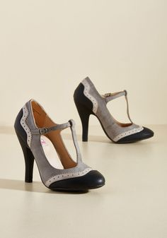 Accomplished Visionary Heel | Mod Retro Vintage Heels | ModCloth.com  A list of incredible accomplishments bolsters your rep, to which you can add the acquisition of these T-strap heels! Of course the textured grey diamonds, glossy taupe points, and matte black edges of these faux-leather pumps caught your eye - their look was made for innovative mavens like you.