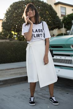 storm wears white skirt from revered with black vans old skool and bianca chandon t-shirt in white class flirt in Newport Cali