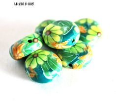 Yellow and Orange Flowers on Green Coin Beads by polymerclaybeads, $9.00