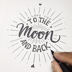 """I love you to the moon and back"" // Quote in black pen on white paper 