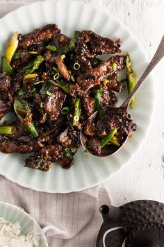 Restaurant recipe for Mongolian Beef. Crispy marinated strips of beef tossed in a sticky sauce. Healthier and tastier than PF Changs!