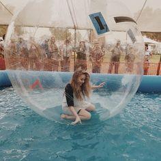 Sabrina Carpenter walking on water.