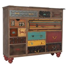 add molding and bits to dresser drawers and paint each one with a different twist