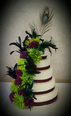 Peacock plum lime and feathers wedding cake by Karen's Kaykes