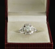 This is terrific!  Offered for sale this truly exquisite antique Diamond solitaire ring  A rare find!  Genuine Art Deco, delightful crafting of the time made in distinctive buckle design, crowned by a large size old Diamond full of glistening light  The ring has been hand crafted during the time (1925 ca) this is a genuine Art Deco piece – made of solid 18 KT white gold – marks are totally worn so we tested it for 18 KT The ring has been constructed with a delightful architectural buckle…