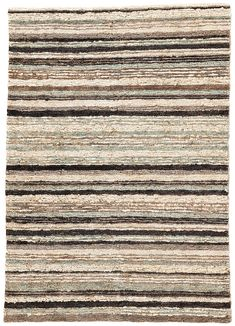 Rich with texture and eco-friendly charm, the Hemlock Sutherland rug features a dimensional design and rich color palette. The ticking stripe pattern features soft blue, tan, and black melded together for a coastal look with a moody twist. Hand-knotted of 100% jute, the looped fibers provide a unique and natural feel.